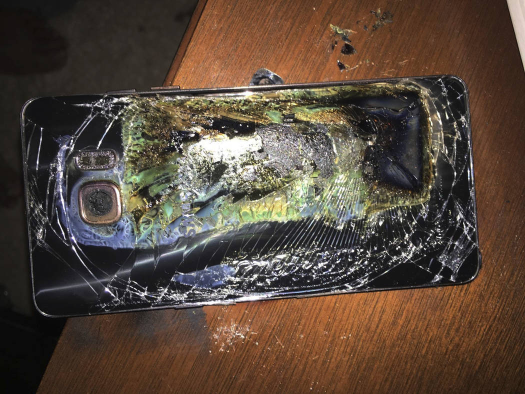 A damaged Samsung Galaxy Note 7 is seen on a table Oct. 9, 2016, in Richmond, Va., after it caught fire earlier in the day. On Tuesday, March 28, 2017, Samsung said it's considering bringing the r ...