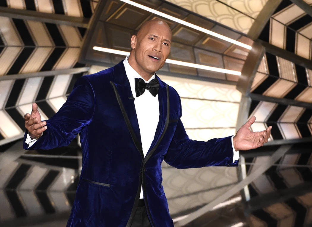 """Dwayne Johnson introduces a performance from best original song nominee """"How Far I'll Go"""" from """"Moana"""" at the Oscars on Sunday, Feb. 26, 2017, at the Dolby Thea ..."""