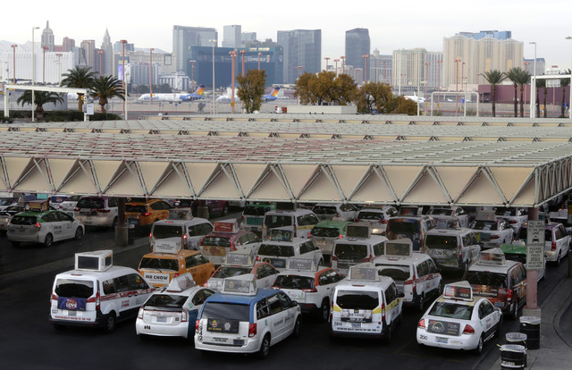 Taxis line up at McCarran Airport Wednesday, Dec. 14, 2016, in Las Vegas. (Bizuayehu Tesfaye/Las Vegas Review-Journal)@bizutesfaye
