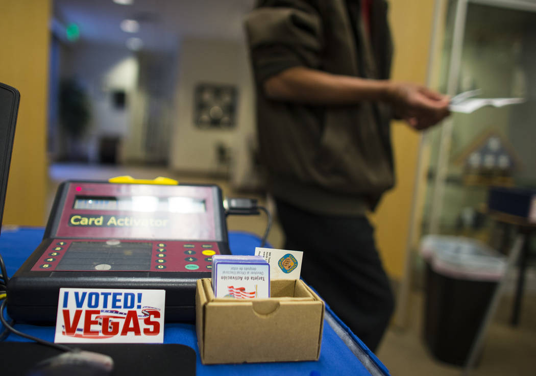 Samban Samuel Khin, a first time voter, prepares to vote early ahead of the Las Vegas municipal election at Las Vegas City Hall on Tuesday, March 28, 2017. (Chase Stevens/Las Vegas Review-Journal) ...