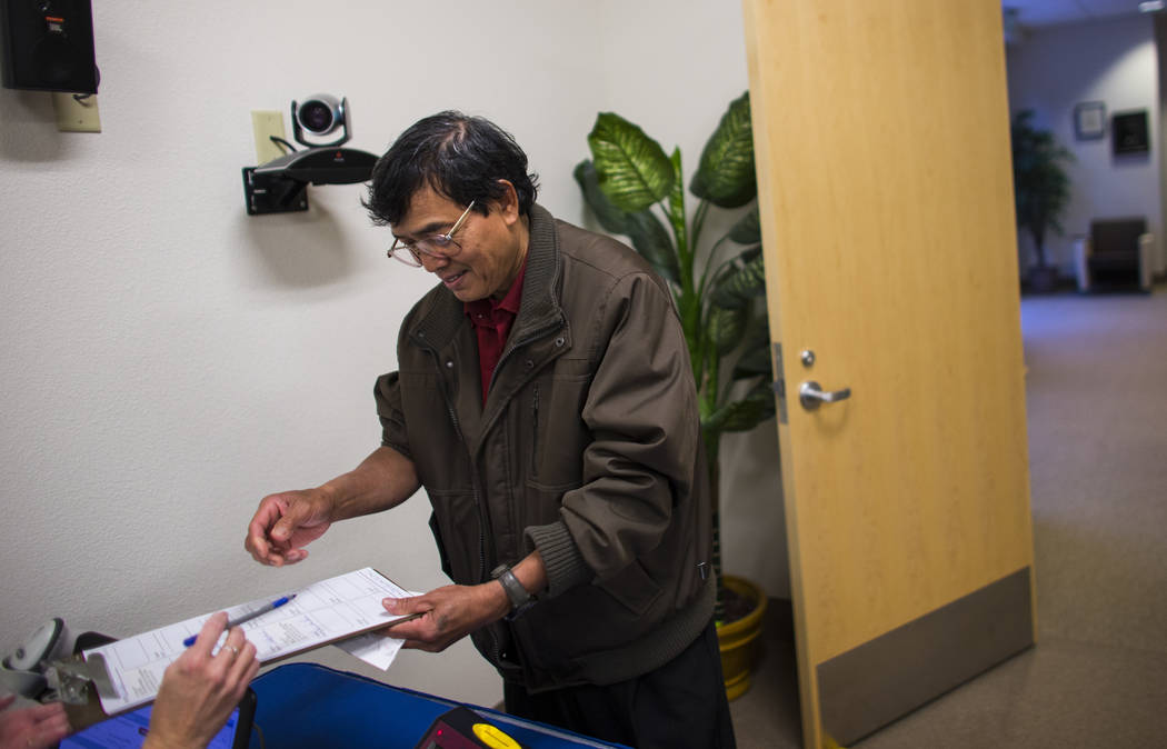 Samban Samuel Khin, a first time voter, checks in to vote early ahead of the Las Vegas municipal election at Las Vegas City Hall on Tuesday, March 28, 2017. (Chase Stevens/Las Vegas Review-Journal ...