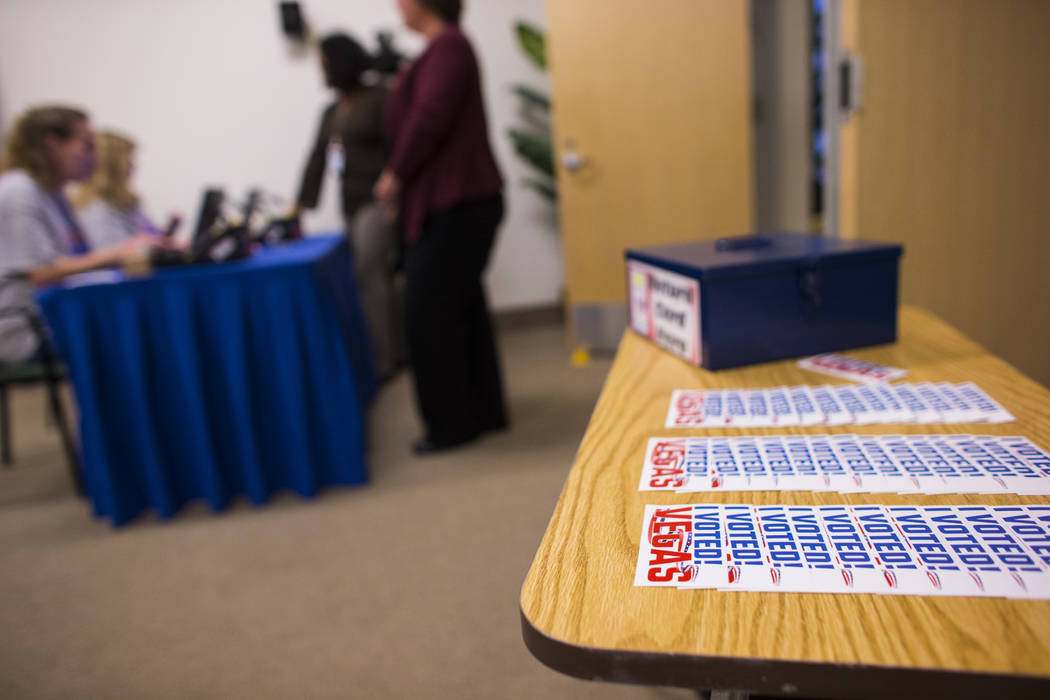 People check in before voting early in the Las Vegas municipal election at Las Vegas City Hall on Tuesday, March 28, 2017. (Chase Stevens/Las Vegas Review-Journal) @csstevensphoto