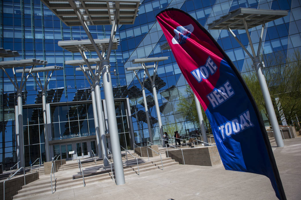 A sign urges people to participate in early voting ahead for the Las Vegas municipal election at Las Vegas City Hall on Tuesday, March 28, 2017. (Chase Stevens/Las Vegas Review-Journal) @csstevens ...