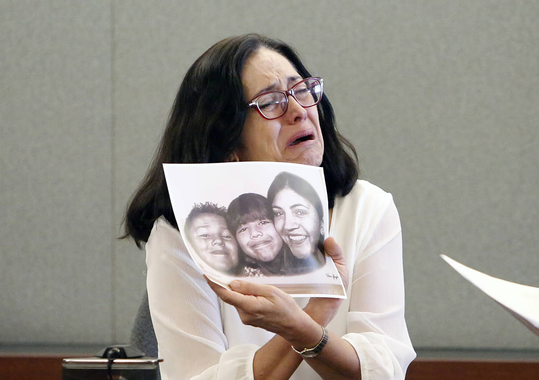 Martha Righetti, mother of Javier Righetti, gets emotional as she displays a picture of her children while testifying at her son's penalty hearing at the Regional Justice Center on Tuesday, March  ...