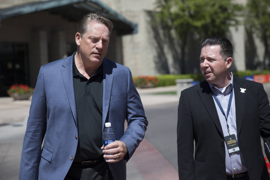 Oakland Raiders head coach Jack Del Rio, left, with team media relations member Will Kiss during day three of the NFL Annual Meeting at the Arizona Biltmore Hotel on Tuesday, March 28, 2017, in Ph ...