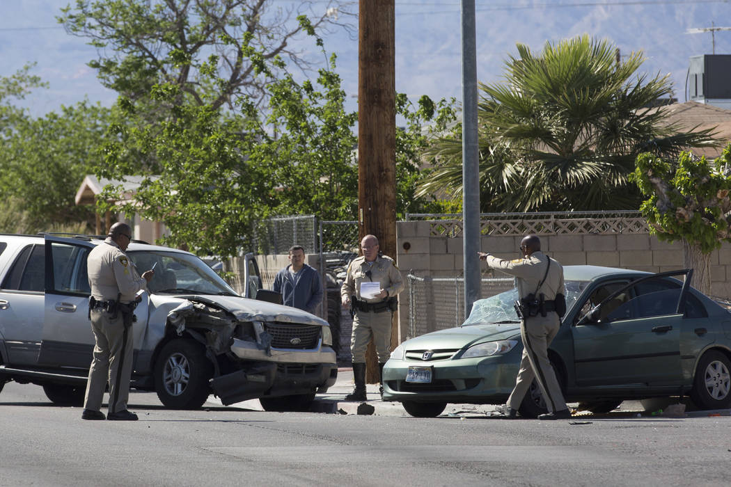 Officers survey damages of an accident near the intersection of I Street and Washington Avenue on Tuesday, March 28, 2017, in Las Vegas. A juvenile was transported to UMC. (Bridget Bennett/Las Veg ...