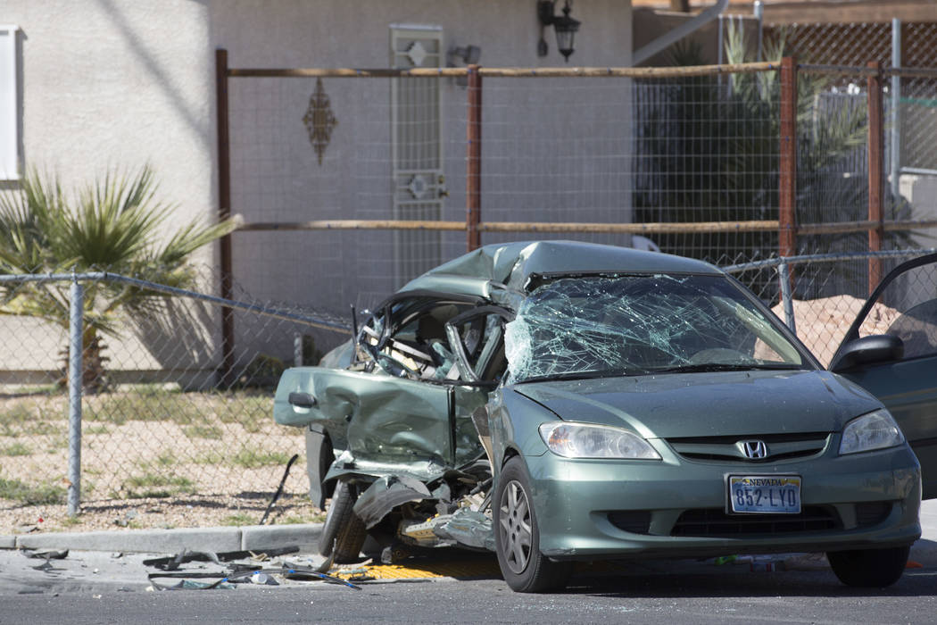 A Honda involved the accident sits damaged near the intersection of I Street and Washington Avenue on Tuesday, March 28, 2017, in Las Vegas. A juvenile was transported to UMC. (Bridget Bennett/Las ...