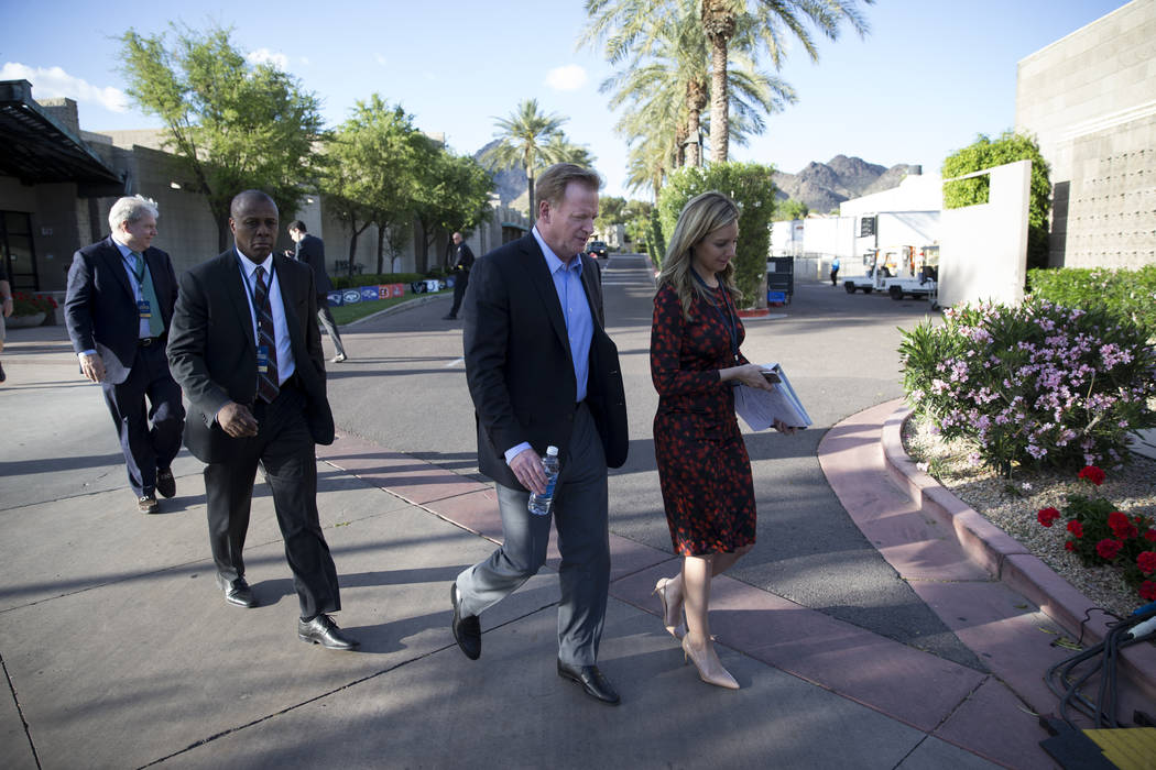 NFL Commissioner Roger Goodell, center, after attending a press conference in the NFL Annual Meeting at the Arizona Biltmore Hotel on Tuesday, March 28, 2017, in Phoenix, Ariz. (Erik Verduzco/Las  ...