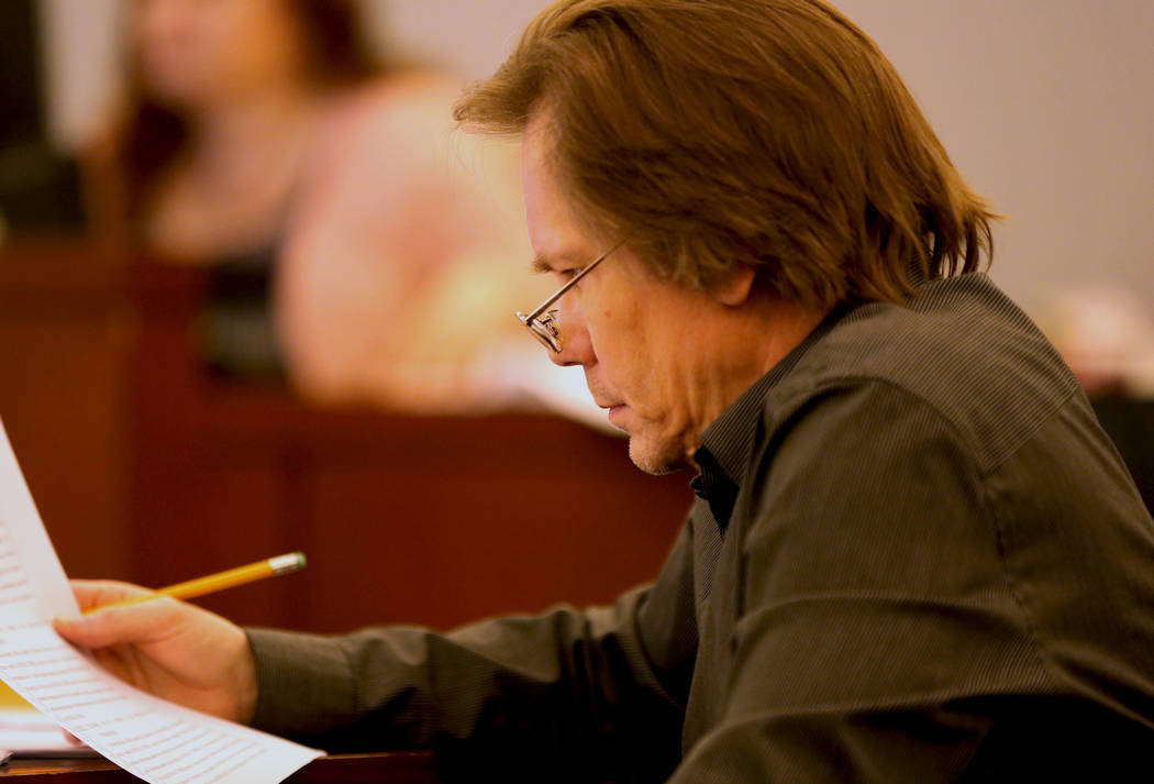 Melvyn Sprowson reads his defense notes before closing statements at the Regional Justice Center in Las Vegas, Thursday, March 30, 2017. (Gabriella Benavidez/Las Vegas Review-Journal) @gabbydeebee