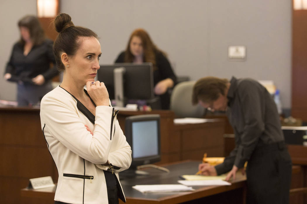 In the foreground prosecutor Jacqueline Bluth waits for the jury to enter while in the background defendant Melvyn Sprowson, who is representing himself, writes something down at Regional Justice  ...