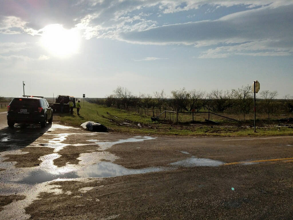 Texas Department of Public Safety troopers investigate a two-vehicle crash that left three storm chasers dead Tuesday, March 28, 2017, near Spur, Texas. (Ellysa Gonzalez/Lubbock Avalanche-Journal/AP)