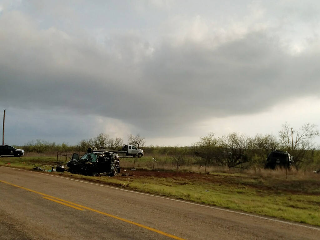 Texas Department of Public Safety troopers investigate a two-vehicle crash that left three storm chasers dead Tuesday , March 28, 2017, near Spur, Texas. (Ellysa Gonzalez/Lubbock Avalanche-Journal/AP)
