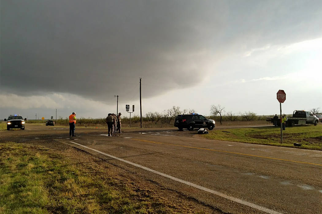 Texas Department of Public Safety troopers investigate a two-vehicle crash that left three storm chasers dead Tuesday, March 28, 2017, near Spur, Texas. The storms spawned multiple funnel clouds a ...