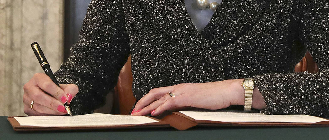Close up of Britain's Prime Minister Theresa May as she signs the official letter to European Council President Donald Tusk, in 10 Downing Street, London, Tuesday March 28, 2017, invoking Article  ...