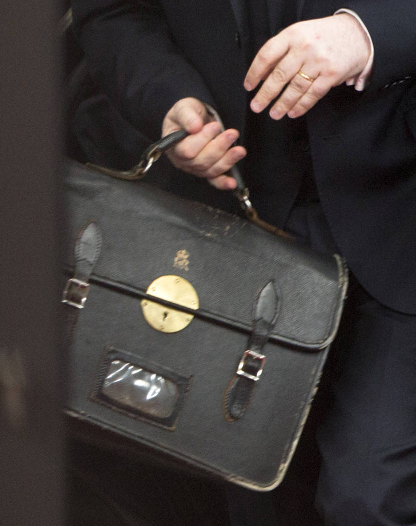 Tim Barrow, the UK Permanent Representative to the EU, carries a briefcase as he arrives at the Europa building in Brussels on Wednesday, March 29, 2017. British Prime Minister Theresa May has sig ...