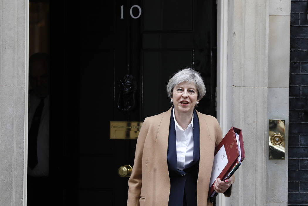 Britain's Prime Minister Theresa May leaves 10 Downing Street on her way to the House of Commons in London, Wednesday March 29, 2017. May will speak to Parliament to announce that Britain is set t ...