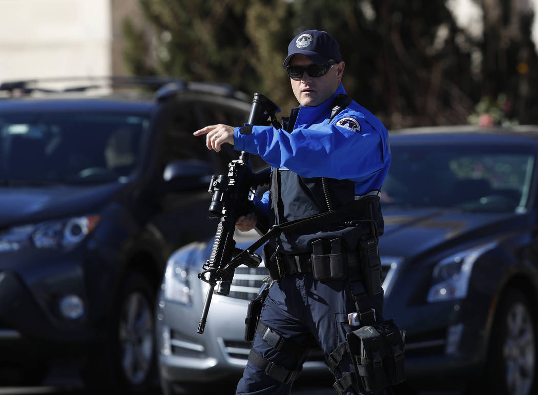 Armed U.S. Capitol Police officer take position near the Botanic Gardens in Washington, Wednesday, March 29, 2017. A woman struck a U.S. Capitol Police cruiser with a vehicle near the Capitol and  ...