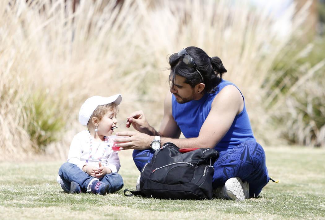 Miguel Dugarte feeds his daughter Arantza, 2, at Potosi Park on Wednesday, March 29, 2019, in Las Vegas. (Bizuayehu Tesfaye/Las Vegas Review-Journal) @bizutesfaye