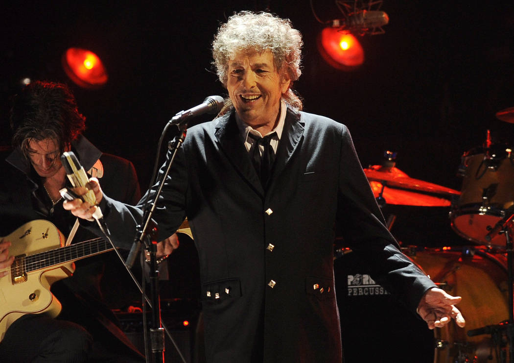 Bob Dylan performs in Los Angeles, Jan. 12, 2012. The Swedish Academy says 2016 Nobel literature winner Bob Dylan will meet with members of the academy this weekend and they will hand over his Nob ...