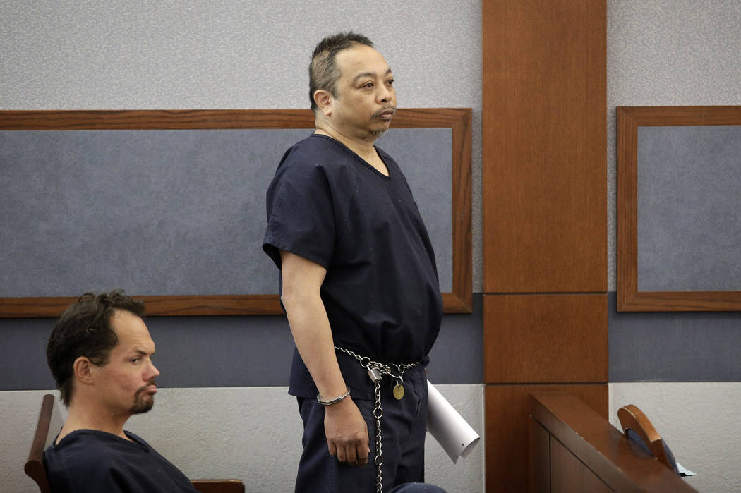 Rolando Cardenas, right, waits to make an initial court appearance Wednesday, March 29, 2017, in Las Vegas. (John Locher/AP)