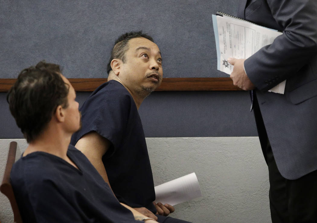 Rolando Cardenas, center, speaks with an attorney after appearing in court, Wednesday, March 29, 2017, in Las Vegas. (John Locher/AP)