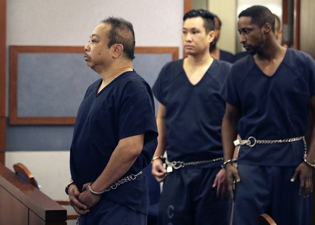 Rolando Cardenas, left, arrives in court Wednesday, March 29, 2017, in Las Vegas. (John Locher/AP)