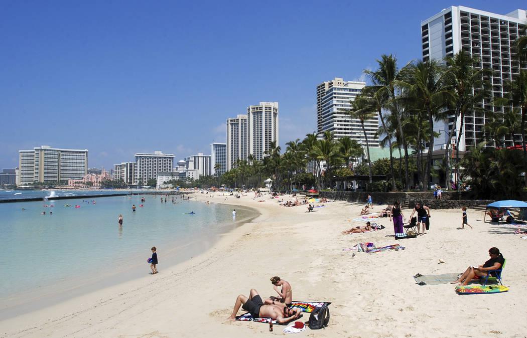 People on the beach in Waikiki, Honolulu on Monday, March 13, 2017. (Caleb Jones/AP)