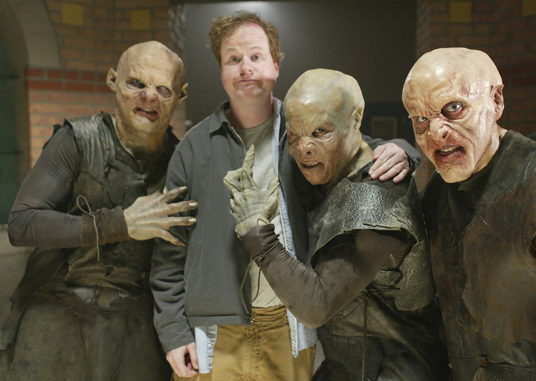 "In this April 16, 2003 file photo, Buffy the Vampire Slayer"" creator Joss Whedon is surrounded by vampires during the taping of the final episode of the cult comedy-horror series in Santa Monica,  ..."