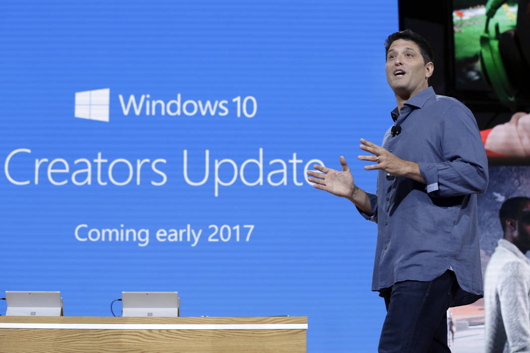 In this Wednesday, Oct. 26, 2016, file photo, Terry Myerson, Microsoft's executive vice president of the Windows and Devices Group, discusses a Windows 10 update at a Microsoft media event in New  ...