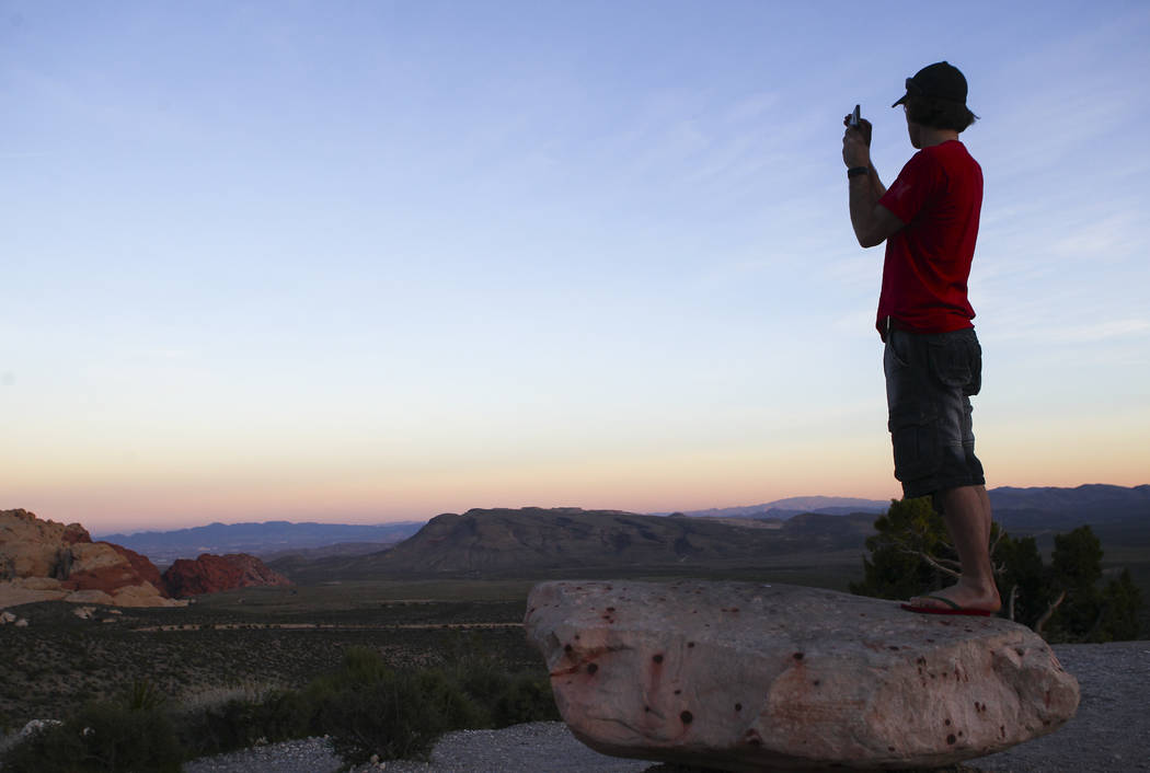 Geoff Mintenko of Canada records the sunset at Red Rock Canyon National Conservation Area outside of Las Vegas on Wednesday, March 29, 2017. (Chase Stevens/Las Vegas Review-Journal) @csstevensphoto
