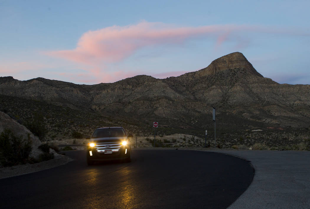 A car drives along the 13-mile scenic drive at Red Rock Canyon National Conservation Area outside of Las Vegas on Wednesday, March 29, 2017. (Chase Stevens/Las Vegas Review-Journal) @csstevensphoto