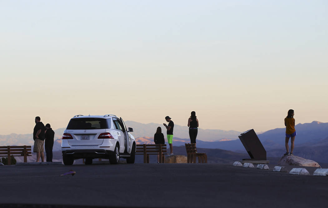 People take in the view from High Point Overlook at Red Rock Canyon National Conservation Area outside of Las Vegas on Wednesday, March 29, 2017. (Chase Stevens/Las Vegas Review-Journal) @cssteven ...