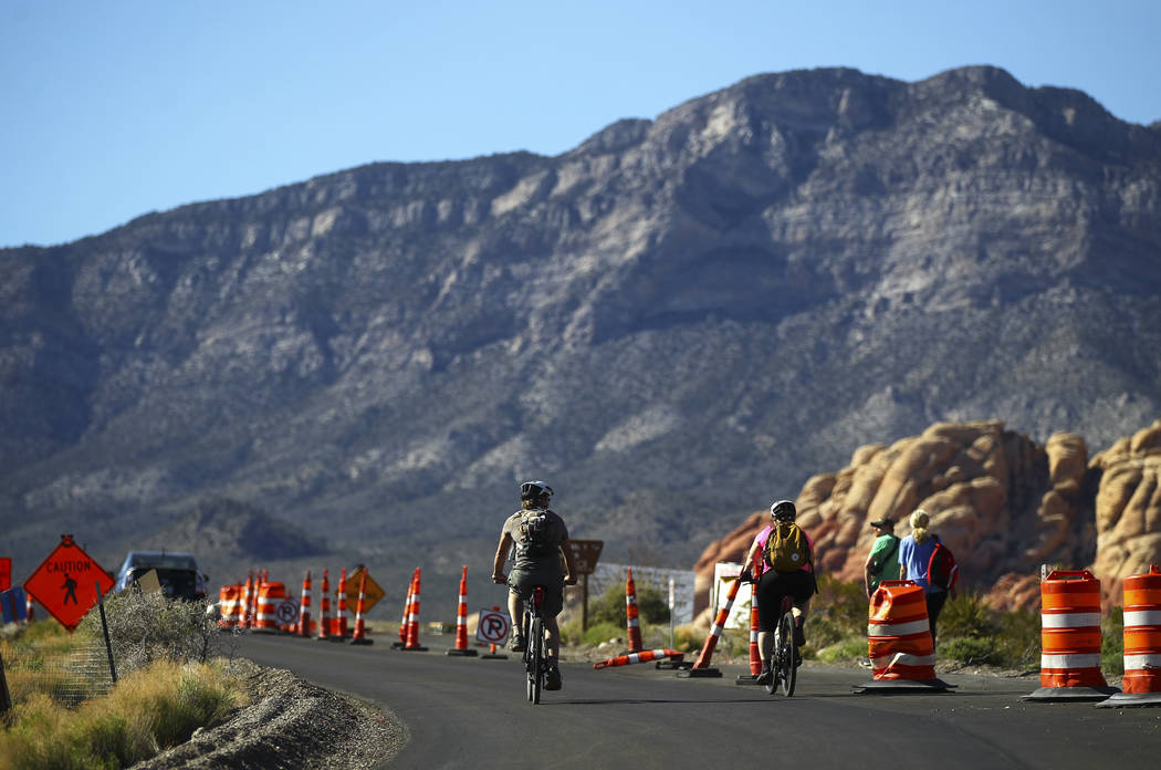 Cyclists make their way along the 13-mile scenic drive at Red Rock Canyon National Conservation Area outside of Las Vegas on Wednesday, March 29, 2017. (Chase Stevens/Las Vegas Review-Journal) @cs ...