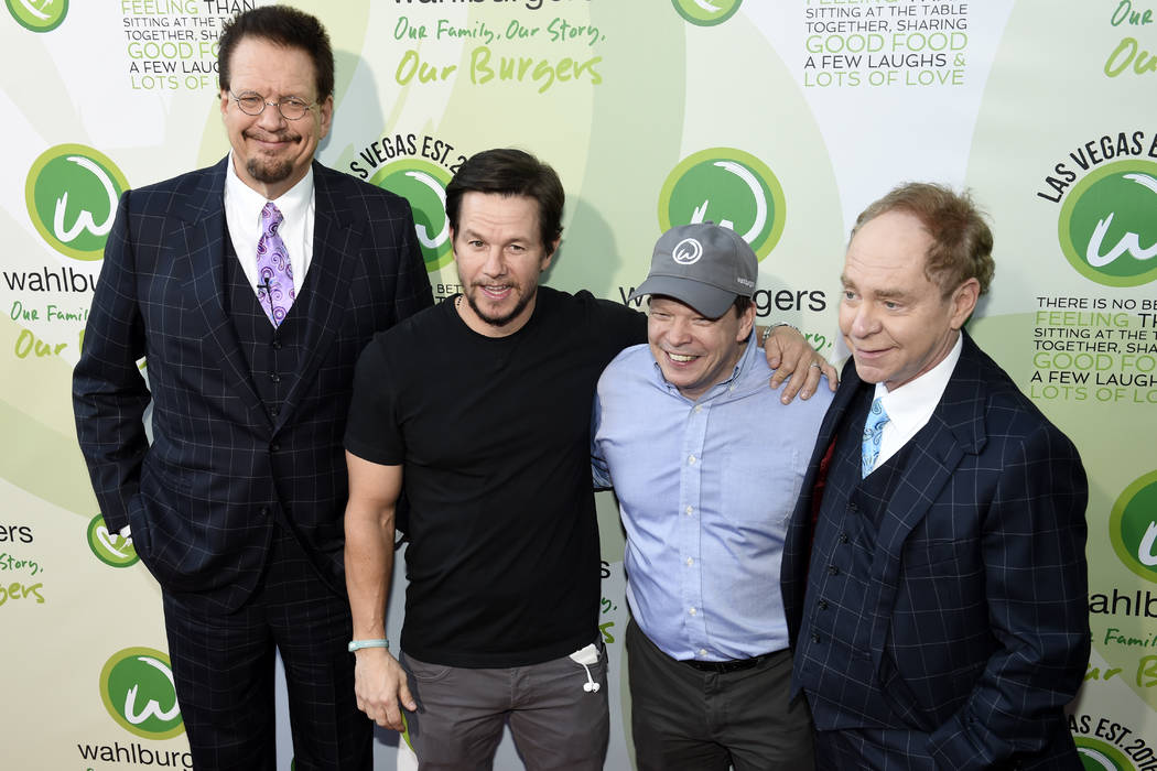 Penn Jillette, Mark Wahlberg, Paul Wahlberg and Teller pose for photos as they arrive at a VIP event at Wahlburgers Las Vegas in the Grand Bazaar Shops at Bally's Tuesday, March 28, 2017. Sam Morr ...