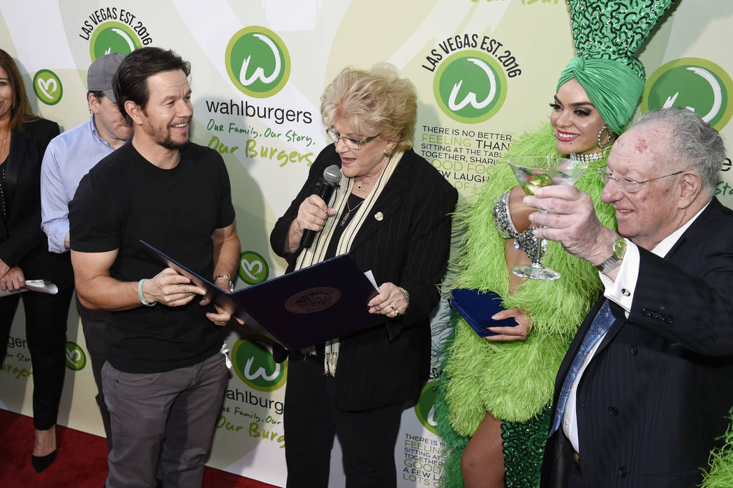 "Las Vegas Mayor Carolyn Goodman reads a proclamation calling March 28th as ""Wahlburgers Day"" as Mark Wahlberg holds it during a VIP event at Wahlburgers Las Vegas in the Grand Ba ..."