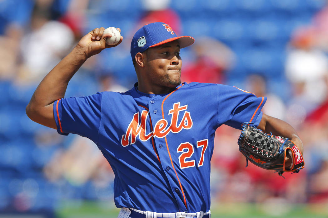 New York Mets relief pitcher Jeurys Familia (27) works against the St. Louis Cardinals in the eighth inning of a spring training baseball game Tuesday, March 28, 2017, in Port St. Lucie, Fla. The  ...