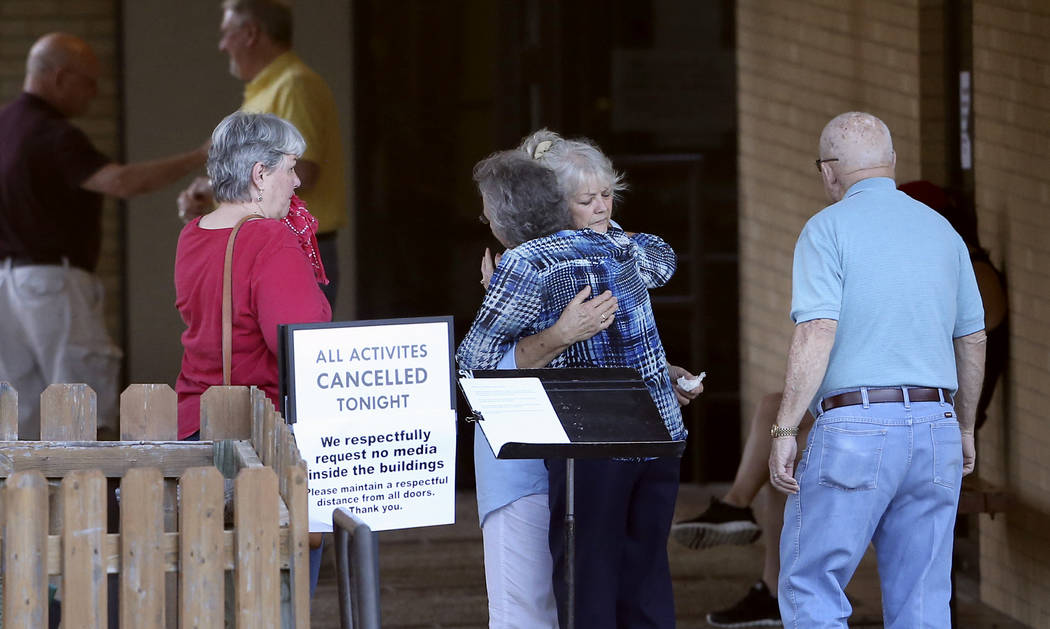 People greet each other outside First Baptist Church after hearing news of the deaths of several members who attended the church in New Braunfels, Texas, Wednesday, March 29, 2017. It was not imme ...