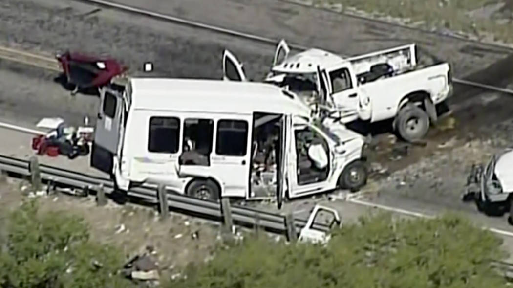 This aerial image made from a video provided by KABB/WOAI shows a deadly crash involving a van carrying church members and a pickup truck on U.S. 83 outside Garner State Park in northern Uvalde Co ...