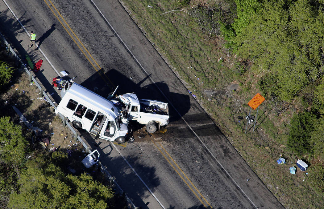 Authorities investigate after a deadly crash involving a van carrying church members and a pickup truck on U.S. 83 outside Garner State Park in northern Uvalde County, Texas, Wednesday, March 29,  ...