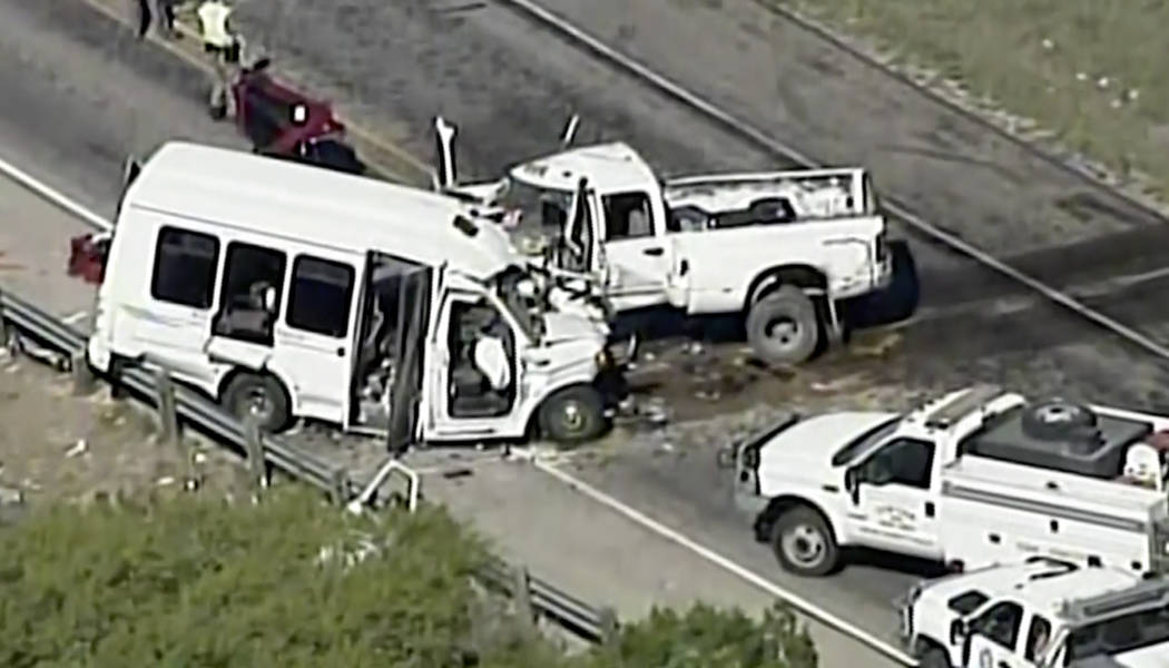In this aerial image made from a video provided by KABB/WOAI authorities respond to a deadly crash involving a van carrying church members and a pickup truck on U.S. 83 outside Garner State Park i ...