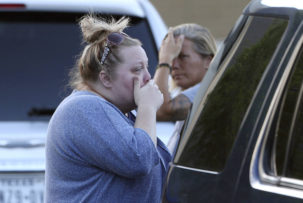 Marilee White, left, with sister Jaime White react outside First Baptist Church in New Braunfels, Texas, after several people who attended the church died in a two vehicle collision Wednesday, Mar ...
