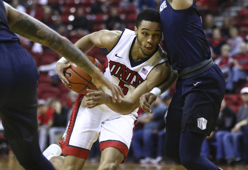 UNLV guard Jalen Poyser (5) drives against Utah State during a basketball game at the Thomas & Mack Center in Las Vegas on Wednesday, March 1, 2017. UNLV won 66-59, ending their nine-game losi ...
