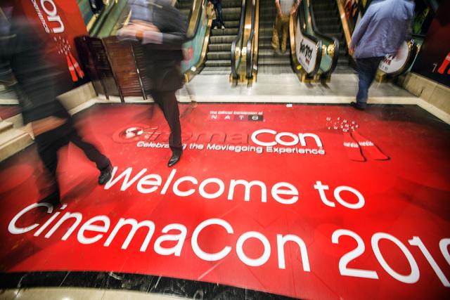 People walk off an escalator during CinemaCon at Caesars Palace on Wednesday, April 13, 2016. Jeff Scheid/Las Vegas Review-Journal Follow @jlscheid