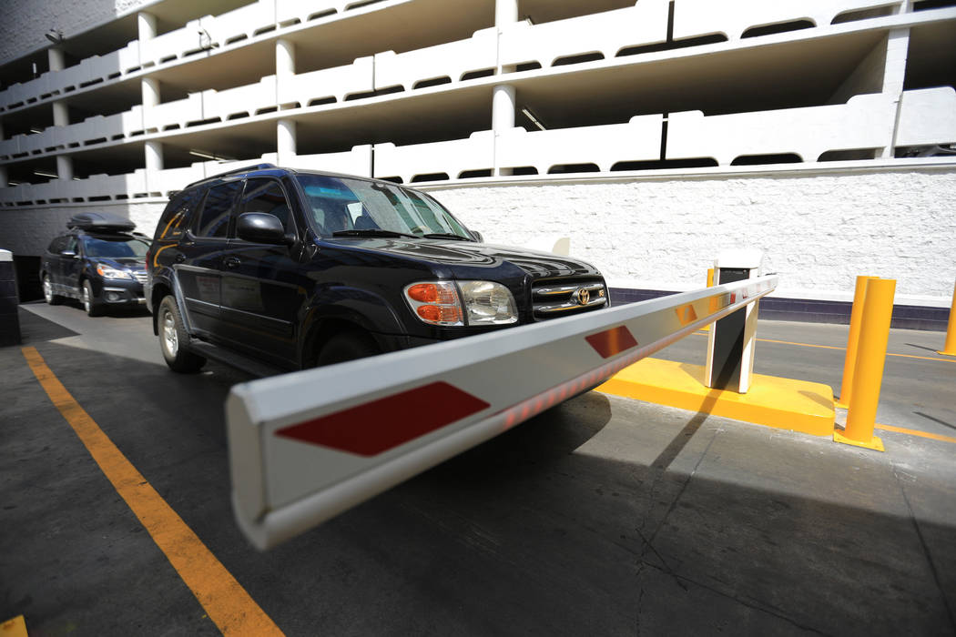 Drivers stop to work the new parking gates at the Linq hotel-casino in Las Vegas on Thursday, March 30, 2017. Some Caesars Entertainment properties have begun charging for parking. Nevada resident ...