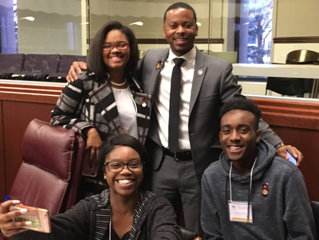 Clark County high school student Kenya Finley takes a selfie with fellow students Malakai Prudent, right, and A'Tymn Hall and Assemblyman William McCurdy II at the Legislature on Thursday, March 3 ...