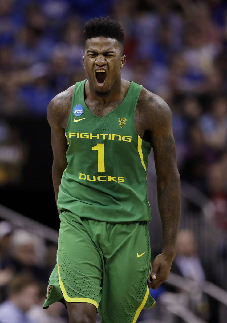 Oregon forward Jordan Bell celebrates during the first half of the team's Midwest Regional final against Kansas in the NCAA men's college basketball tournament, Saturday, March 25, 2017, in Kansas ...