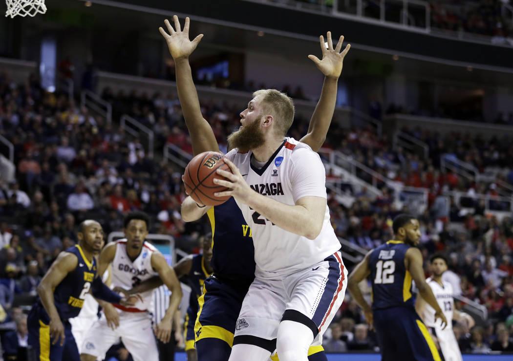 Gonzaga center Przemek Karnowski shoots against West Virginia during the second half of an NCAA Tournament college basketball regional semifinal game Thursday, March 23, 2017, in San Jose, Calif.  ...