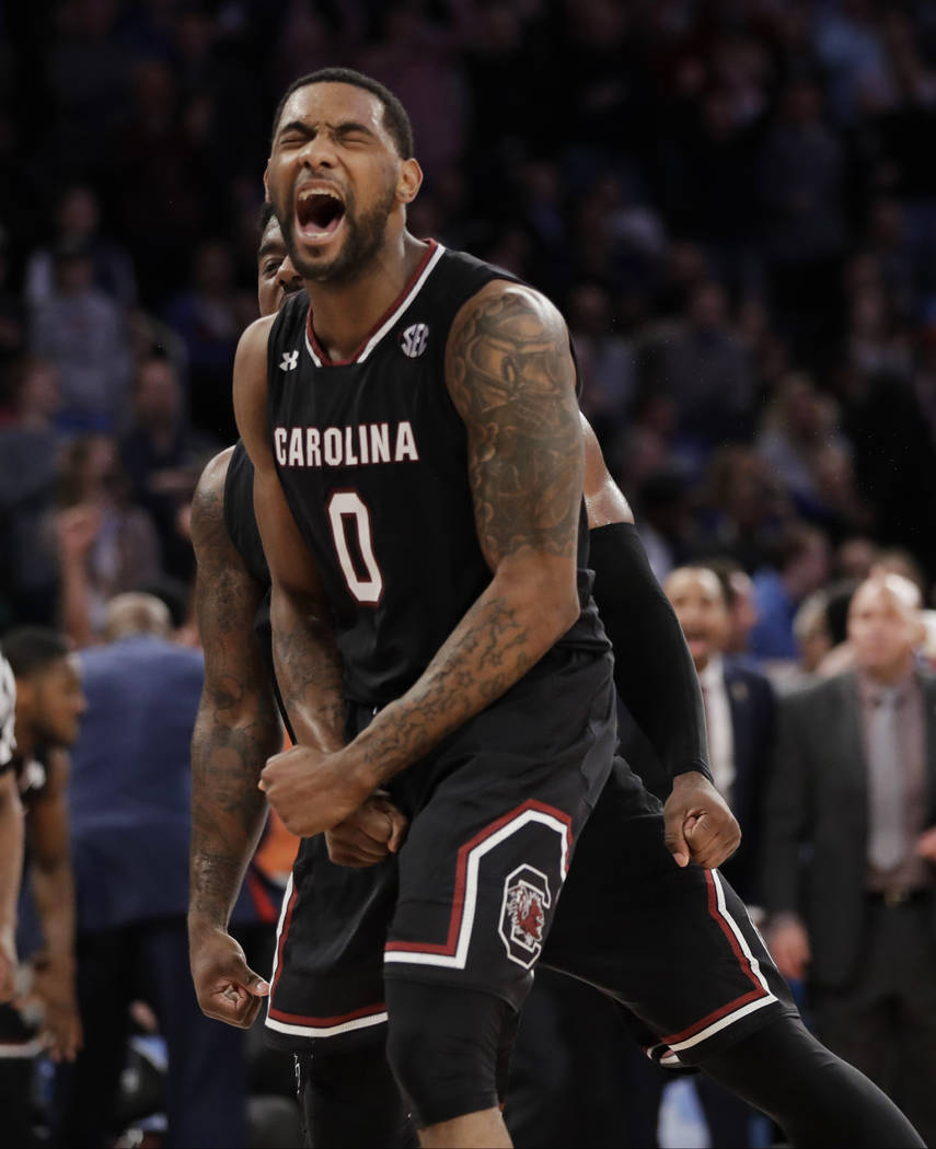 South Carolina guard Sindarius Thornwell (0) reacts after dunking the ball against Florida during the second half of the East Regional championship game of the NCAA men's college basketball tourna ...