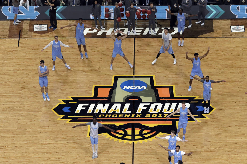 North Carolina players warms up during a practice session for their NCAA Final Four tournament college basketball semifinal game Friday, March 31, 2017, in Glendale, Ariz. (AP Photo/Morry Gash)