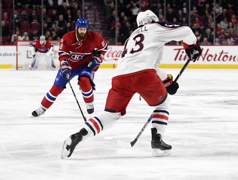 Feb 28, 2017; Montreal, Quebec, CAN; Montreal Canadiens defenseman Jordie Benn (8) defends against Columbus Blue Jackets forward Scott Hartnell (43) during the first period at the Bell Centre. Man ...